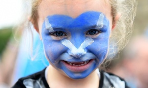 No point in removing  face paint just yet,  child - you will need it for the dancing very soon...